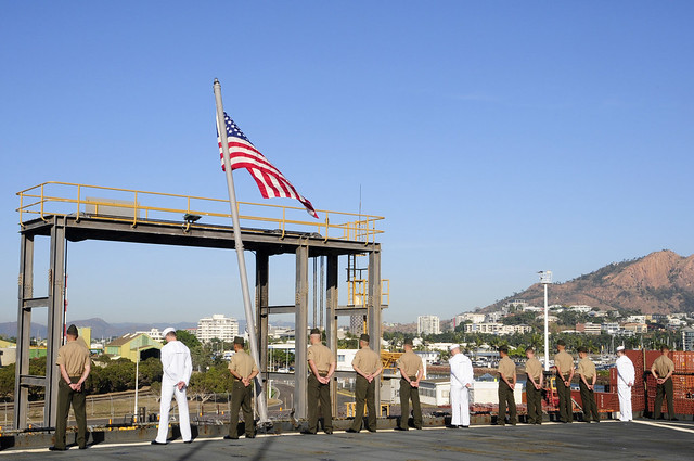 Sailors and Marines onboard USS Germantown (LSD 42) man the rails in Townsville, Australia