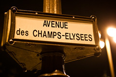 Champs-Elysees (jrobblee) Tags: street light paris france sign night canon dark french eos words europe post bokeh letters champs nighttime avenue elysees avenuedeschampselysees 50d