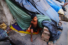 slum colors II (Jenny [ www.colorandlightphotography.com ]) Tags: life morning net breakfast children living bed child poor mother mosquito dhaka roadside shelter bangladesh slum daybreak mosquitonet streetside polythene proverty gettyimagesbangladeshq2 gettyimagesbangladeshq3