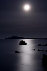 Moon and sea, infinite calm (Ahio) Tags: longexposure sea moon seascape night mediterranean nocturnal luna fullmoon explore moonlight menorca fornells balearicislands tirant cavallería samola smcpentaxda35mmf28 pentaxk5