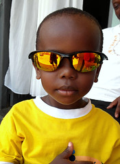 Little Boy Yellow (cowyeow) Tags: africa boy people cute smile sunglasses yellow kids youth children fun cool funny child little sweet african small young smiles adorable attitude uganda littleboy kasese funnyafrica