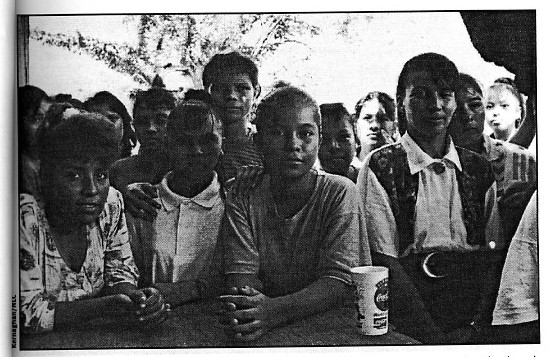Fifteen-year-old Wendy Diaz (center) with co-workers at Global Fashions Factories in Honduras where they made Kathie Lee for Wl-Mart; Kernaghan/NLC