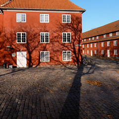 The shadow of victory at the Kastellet the Citadel (Bn) Tags: park houses shadow red castle monument public copenhagen geotagged denmark site construction topf50 europe shadows citadel military ministry historic ramparts danish area walls fortification bastion topf100 complex defence cultural kastellet starshaped 100faves 50faves hjemmevrnet forsvarets auditrkorps geo:lon=12594763 geo:lat=55691553 341yearold