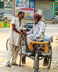 Friends and a baby..   Punjab, India (Manreet.D) Tags: life people baby india streets art tourism beautiful beauty smile happy amazing cool interesting sitting peace hand friendship happiness tourist story shake punjab rickshaw society the