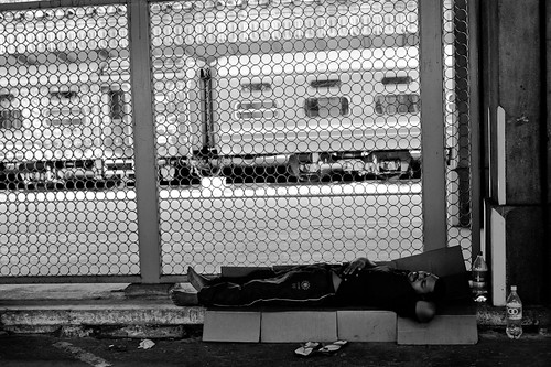 A man sleeping at Tanjong Pagar KTM Railway Station.