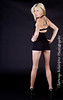 Smokin hot blonde woman in a cute little short black dress. Model: Maili 5'