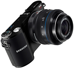 "Samsung NX200, with 20.3 megapixels, APS-C CMOS sensor, 1920x1080/30p (H.264) HD movie recording, and 3.0"" VGA AMOLED display."