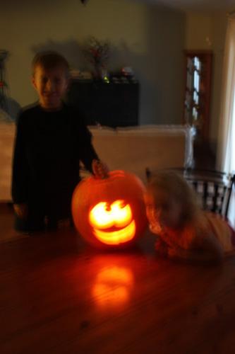Kids-with-lit-up-pumpkin