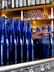 blue bottles and the odd disembodied hand (lam 09) Tags: blue motion paris reflection hand counter bottles blu odd mano movimento bartender pastis disembodied snatch bottiglie parigi aperitif mosso bluebottles chezjanou