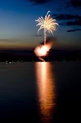 Fireworks2 (EthanHeed) Tags: longexposure light sunset lake reflection water nikon fireworks sigma lighttrails bluehour 4thofjuly nikond7000 fotocompetitionfotocompetitionbronze