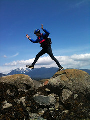 rock jumping (Lazarowich) Tags: people man mountains guy nature landscape fun outdoors happy high jumping rocks action expression helmet midair recreation blueskies elevation airborne celebrate