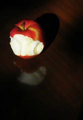 Apple Bite for Steve Jobs (floralgal) Tags: red stilllife reflection apple fruit stem redapple galaapple tabletopstilllife biteofapple