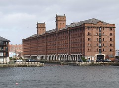 Old Liverpool Warehouse (Tony Worrall) Tags: old city uk england urban building brick wet water architecture modern liverpool docks design photo apartments northwest image north stock warehouse british tall past mersey relic scouse meseyside 2011tonyworrall