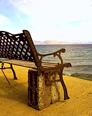 This bench has an artificial leg - Aυτό το παγκάκι έχει ένα τεχνητό πόδι. (dimitra_milaiou) Tags: life wood old blue autumn sea 2 two sky people sun fall love beach water swim bench lost greek happy one 1 see design nokia wooden rust iron europe day village view heart time walk steel horizon feel leg joy hellas lifestyle happiness artificial greece sit planet imagination emotions metalic feelings peloponissos dimitra hellenic x6 diakofto diakopto ελλαδα φθινόπωρο δυο νερο πελοπονησσοσ artofimages πελοπόνησσοσ φθινοπωρο ενα δημητρα globalinterest milaiou μηλαιου dimitramilaiou