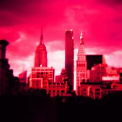 Manhattan (daveknapik) Tags: nyc newyorkcity pink red newyork 120 film skyline skyscraper buildings mediumformat square xpro crossprocessed fuji skyscrapers manhattan magenta skylines velvia diana empirestatebuilding chryslerbuilding dianaf crossed fujivelvia fujivelvia100