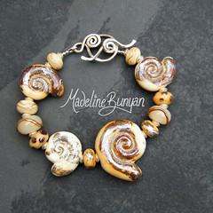 "ammonite bracelet • <a style=""font-size:0.8em;"" href=""https://www.flickr.com/photos/37516896@N05/6266282069/"" target=""_blank"">View on Flickr</a>"