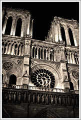 (The New Motive Power) Tags: city shadow paris france detail architecture facade circle catholic glow moody exterior cathedral religion gothic towers dream canond60 historic notredame tall ornate hazy notredamedeparis frontage
