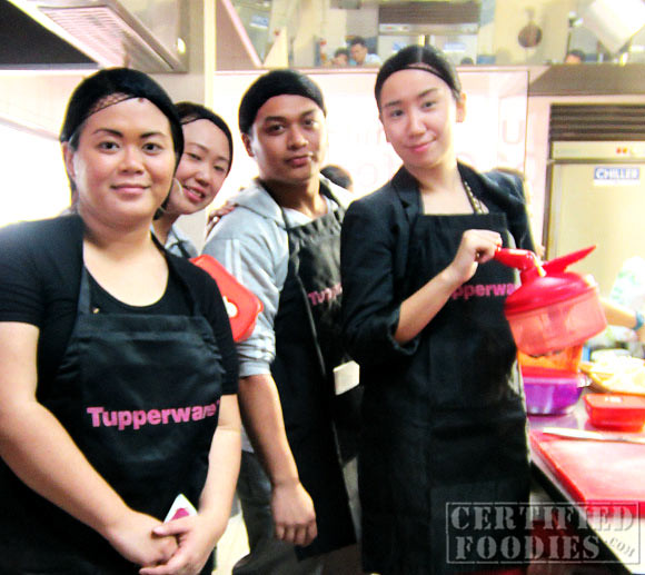 A photo of our team in the CCA Oceana kitchen - ugh, the hair nets!