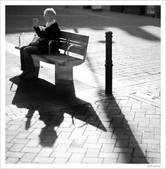 Shadows again (Josh Kemp-Smith) Tags: street uk light shadow woman white black lady contrast bench photography 50mm high nikon cigarette seat derbyshire documentary smith smoking josh kemp derby d3 14g