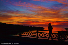 Sunset Solitude (TIA International Photography) Tags: county bridge blue autumn sunset shadow red orange man color guy fall nature silhouette yellow contrast tia de landscape island person gold evening washington october crossing cross juan natural state pacific northwest dusk path walk deception pass pedestrian traverse promenade sound rosario stroll hue strait puget tosin whidbey fuca fidalgo arasi visipix tiascapes tiainternationalphotography