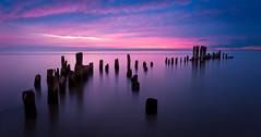 Grosse Pointe Pier Remains (Out Of Chicago) Tags: longexposure beach water clouds sunrise pier illinois lakemichigan evanston posts pinksky dockstreet runied grossepointlighthouse lighthouseparkdistrict