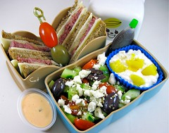 Mini Reuben Bento (Cathryn3) Tags: lunch cucumber swisscheese olive sauerkraut sandwich pineapple bento reuben balsamic greeksalad cornedbeef cottagecheese kalamata vinaigrette thousandislanddressing tomto cocktailryebread