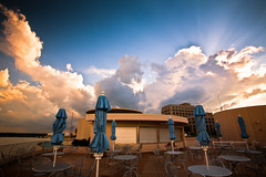 Cloud Vista Caf (Loren Zemlicka) Tags: city blue light sunset summer sky urban usa storm rooftop weather june wisconsin architecture publicspace clouds photography restaurant evening photo cafe midwest closed downtown chairs image dusk empty picture stormy franklloydwright patio madison cumulus tables northamerica rays sunrays umbrellas canonef1740mmf4lusm cloudscape sunbeams stormclouds afterhours mononaterrace lakemonona isthmus 2011 canoneos5d danecounty madison365 portalwisconsinorgselected lorenzemlicka lakevistacafe williamtevjuerooftopgarden portalwisconsinorg062911