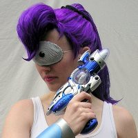 A headshot of a woman dressed like Leela, complete with purple ponytail and raygun