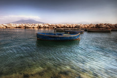 Fishing Boats (TheFella) Tags: ocean sea sky italy cloud seagulls mountain slr birds clouds digital port photoshop canon eos volcano bay coast boat photo high fishing rocks europe italia day waves campania dynamic cloudy harbour boulders photograph processing mountvesuvius napoli naples vesuvius daytime ripples dslr bayofnaples submerged fishingboat range hdr highdynamicrange postprocessing 500d southernitaly photomatix montevesuvio