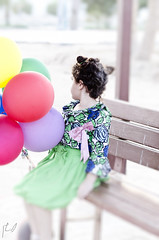 (Ebtesam.) Tags: sunlight blur green girl kid nikon child bokeh balloon 85mm saudi arabia jeddah  ebtesam