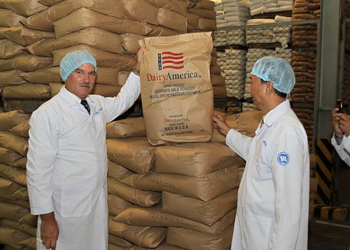 Acting Under Secretary for Farm and Foreign Agricultural Services Michael Scuse (left) tours a Vinamilk factory in Ho Chi Minh City, Vietnam and sees dairy products the company has imported from the United States. Vinamilk is Vietnam's largest dairy processing company and its general manager, Nguyen Quoc Khanh (right) is a 1998 alum of the Foreign Agricultural Service's Cochran Fellowship Program. Scuse was in Vietnam last week leading USDA's first agricultural trade mission there. Photo by Le Sy Hoang Chuong
