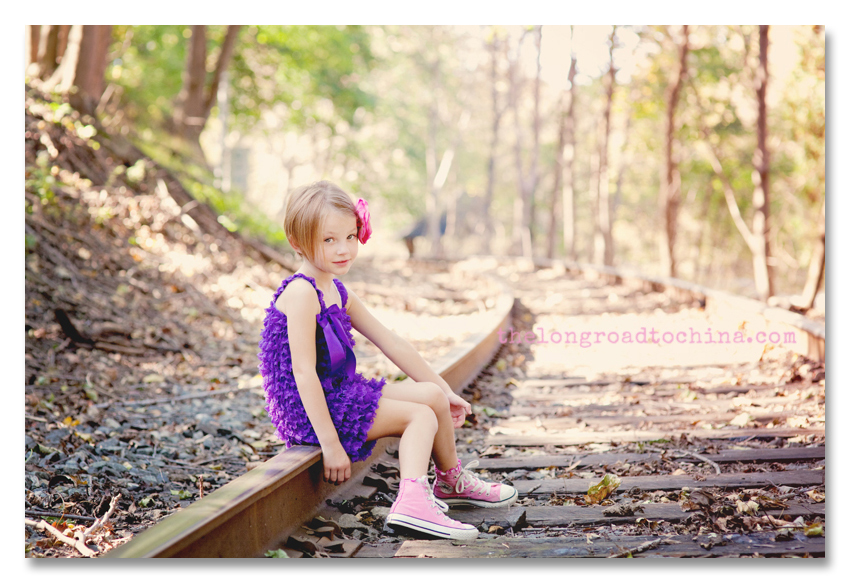 Sarah knees together on the railroad tracks BLOG
