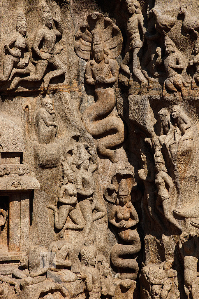 Naga and Nagini in rock cleft, Arjuna's penance bas-relief, Mahabalipuram, Tamil Nadu, India
