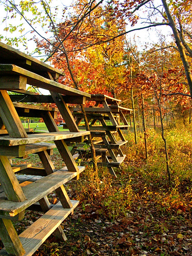 picnic tables stacked for winter