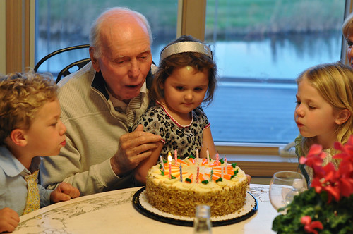 Bennet, Grace and Boanca helping Gramps blow out candles Oct 2011
