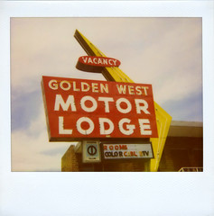 Golden West Motor Lodge (Nick Leonard) Tags: old city red sky white color classic film sign yellow clouds analog vintage polaroid downtown neon rooms nevada nick motel scan retro signage arrow polaroidspectra reno vacancy timeless expiredfilm cabletv motorlodge polaroidcamera dinersclub imagefilm epson4490 polaroidspectrafilm polaroidfilm polaroidspectrasystem nickleonard goldenwestmotorlodge type1200 expired2009