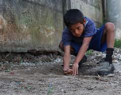 Bryan 1 (juandeleon) Tags: city boy game hand guatemala ciudad dirt mano marbles sight tradition juego mirada nio tierra tradicin canicas cincos
