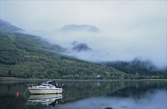 A' Chrois (Ron Layters) Tags: trees mist mountains reflection water fog geotagged scotland boat pentax unitedkingdom earlymorning peaceful slide transparency summit lowtide loch hillside fujichrome provia buoy arrochar pentaxmz10 lochlong argyllandbute achrois ronlayters slidefilmthenscanned mz10 antàrar loomingoutofthemist geo:lat=5620039885800599 geo:lon=4750462935697979