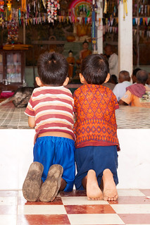 Two boy at a temple hall