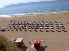 All in a line, Benches and big umbrellas on the beach in Albufeira at 10am its darn hot (Coolcats100) Tags: travel sunset sea beach portugal magazine fuji finepix s9500 albufeira pfb finepixs9500 pfbmag pfbmagazine coolcats100
