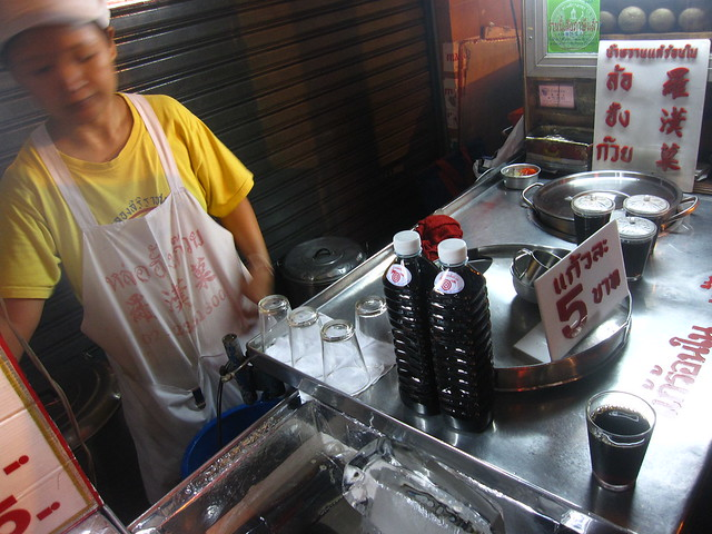 Vendor Selling Black Glass Jelly Juice
