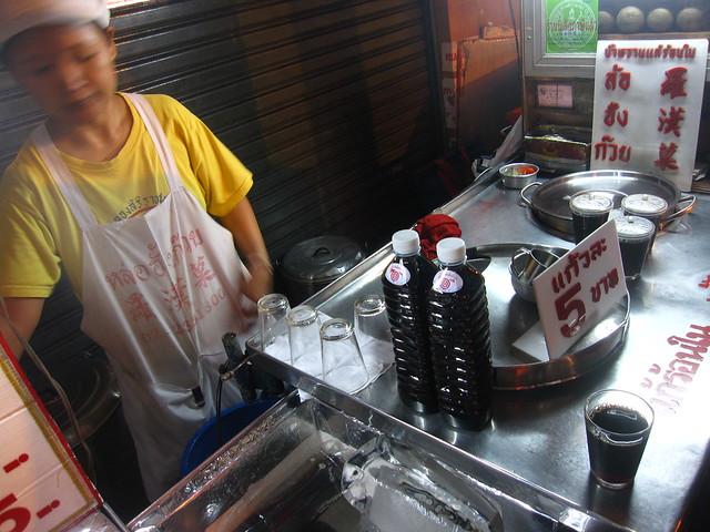 Vendor Selling Black Glass Jelly Juice