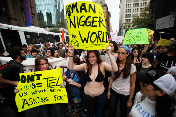 Slutwalk NYC Woman Is the Nigger of the World Sign