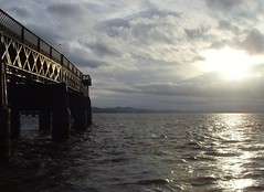 Sunset over the Tay Rail Bridge at Dundee (Tony Worrall Foto) Tags: bridge blue sunset sea wet water beauty weather clouds river season scotland photo waves crossing shine image dundee stock scenic rail railway tay shore serene scotish shimmer 2011tonyworrall
