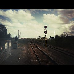 Red stick, Corio. #vline (supacrush) Tags: clouds square railway victoria line stop squareformat normal iphone coria redstick fluffyclouds redsignal vline cloudage instagramapp uploaded:by=instagram