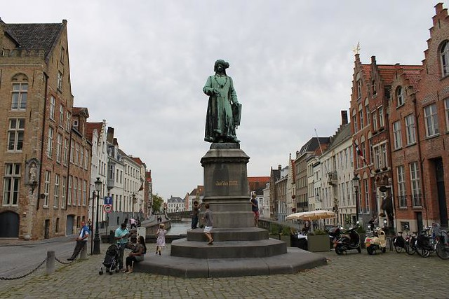 sqaure with statue and surrounded with beautiful houses