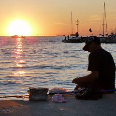 Young man preparing bait for good sunset fishing (Bn) Tags: fishing sea fisherman boys hand holding rod reel outdoor marina men outdoors quality time recreation standing togetherness sailing boat afternoon nautics slovenia piran izola koper bayofpiran adriatic slovene coast cruising nauticalyachts sailboats summer season captain seagull evening enjoy boats pirano port mediterranean cruises border navigation courses lovers portoro yacht small peninsula seacoast waters gulfoftrieste territorial watercolor travelling holiday club popular sailors italian ambience gulfofpiran angelers hats geotagged geo:lon=13724794 geo:lat=45547721 sunset sun young man bait
