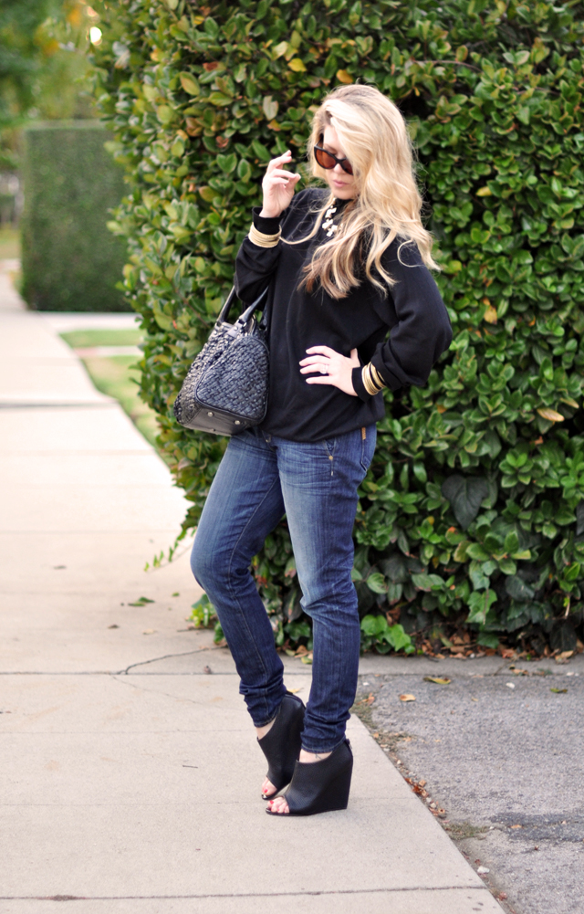 Jeans+black sweater + wedges+brass jewelry