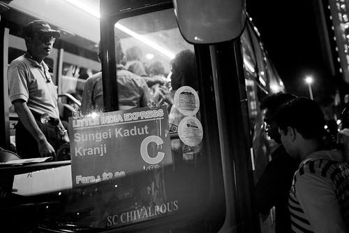 A bus driver watches as foreign workers boarded the bus heading for Sungei Kadut. That is a long way from Little India.