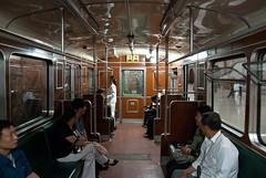 in the company of the kims. (gr0uch0) Tags: travel portrait train subway asia metro korea kimjongil inside northkorea azie reizen azi kimilsung azi